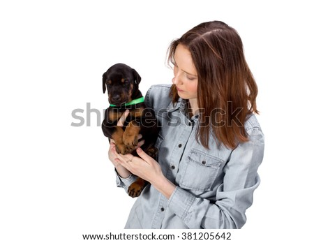 Red girl with black puppy