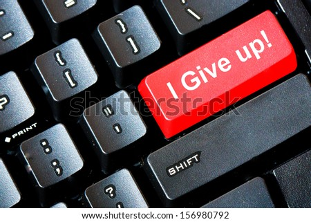 Red Give Up button on a computer keyboard - stock photo