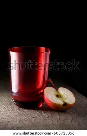 red glass and cut apple