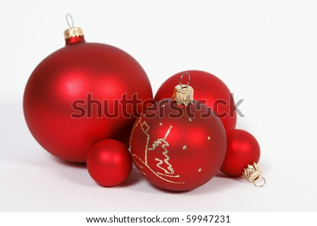 Red glass balls on the white background