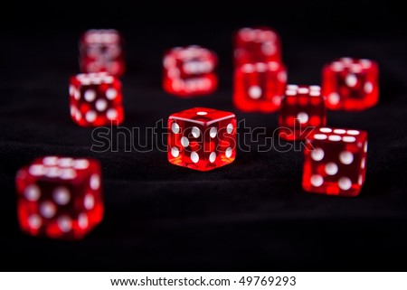 Red glass dices rendered on the black background - stock photo