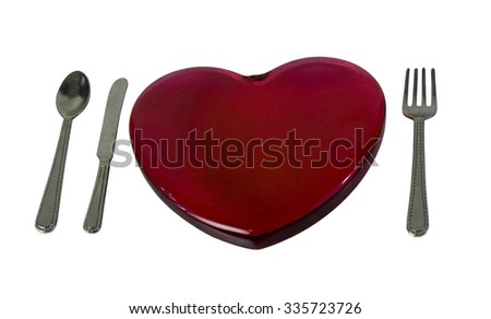 Red glass heart with silverware - path included - stock photo