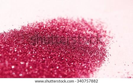 Red glitter on light background - macro photo - stock photo