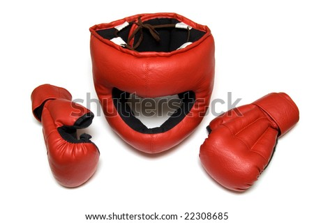 Red gloves for hand-to-hand fight and protective helmet on white background