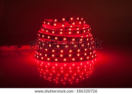 Red glowing LED garland, strip  - stock photo
