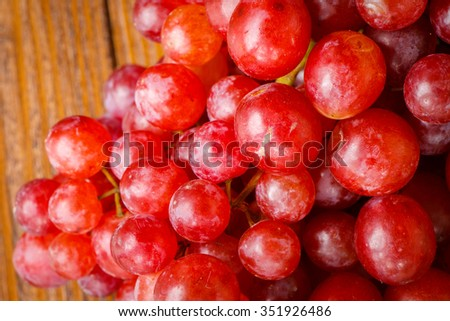 Red grape on wooden background, Healthy concept.