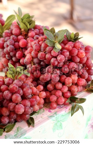 Red grape sale in local market. - stock photo