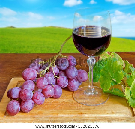 red grape with wine and leaves - stock photo