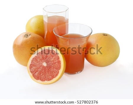 red grapefruit and juice in glass