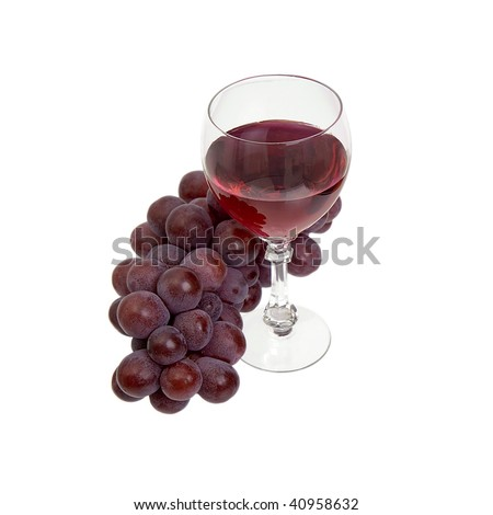 Red grapes and glass with wine on a white background - stock photo