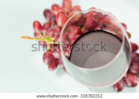 Red grapes and wine in glass - stock photo
