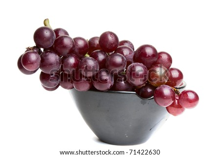 Red Grapes in a bowl isolated on a white background - stock photo