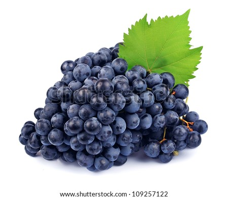 Red grapes with green leaf on white