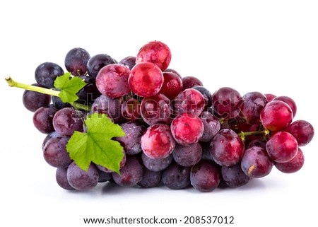 Red grapes with green leaves  - stock photo