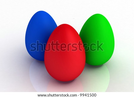 Red, green and blue egg shapes on a reflective surface - stock photo