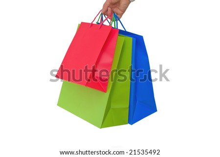 red, green and blue holidays paper-bags for packing presents isolated on white - stock photo