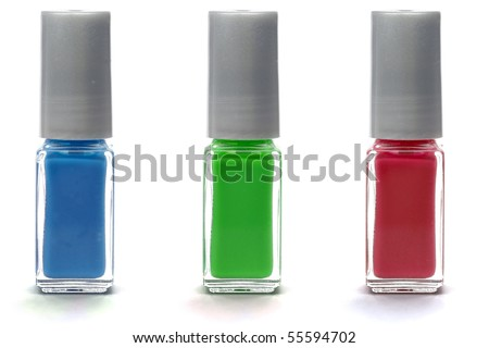 Red, green and blue nail polish isolated on white background. - stock photo