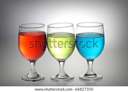 Red, Green, Blue Liquid in the separate glass - stock photo