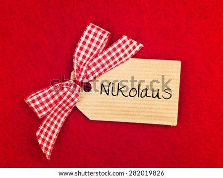 red greeting card background with cute bow - german for St Nicholas' Day - stock photo