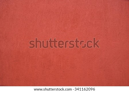 Red grunge cement wall, textured background