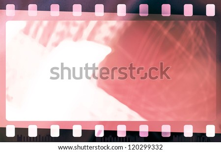 Red grunge film strip frame with light leak - stock photo