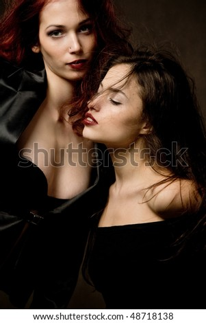 red hair and brunette woman portrait, studio shot - stock photo