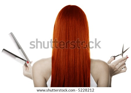 Red hair and hairdresser's tools - stock photo