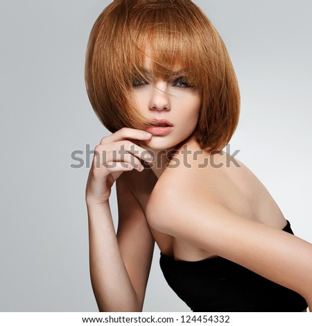 Red Hair. Beautiful Brunette with Short Hair. High quality image. - stock photo