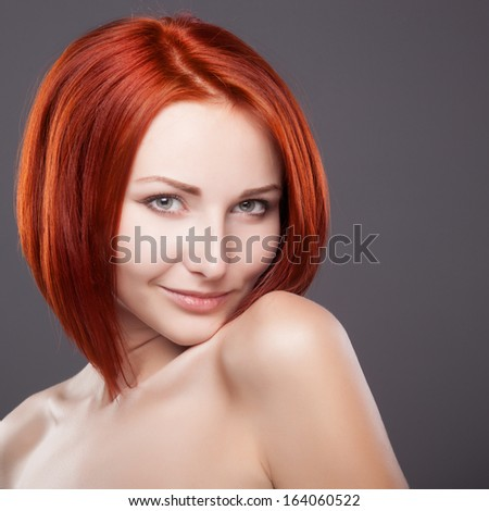 Red hair. Beautiful Woman with Short Hair - stock photo