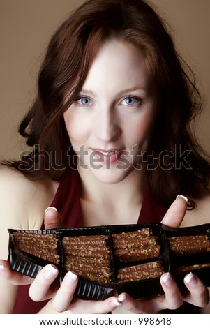 Red hair female holding a box of chocolate