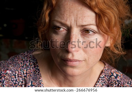 red hair freckled melancholy woman - stock photo