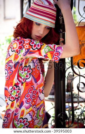 red hair woman in colorful clothes, outdoor shot - stock photo