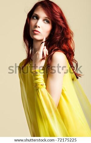 red hair woman in  elegant stylish yellow dress portrait,  studio shot - stock photo