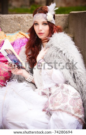 red hair woman in fashionable clothes  read book outdoor shot - stock photo
