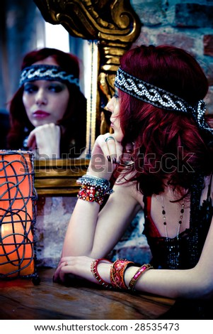 red hair woman looking at the mirror - stock photo