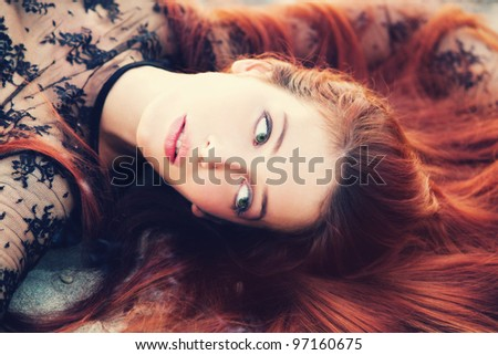 red hair woman portrait outdoors small amount of grain added - stock photo
