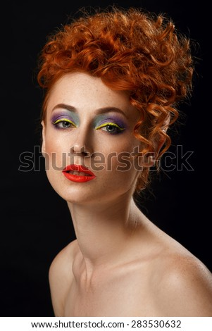 Red-haired. Beautiful girl with bright fashion makeup. Ginger with freckles. Hairstyle. Curly hair.