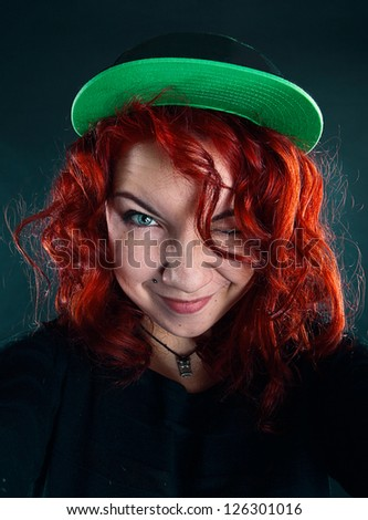 red-haired girl in cap - stock photo
