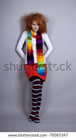 Red-haired girl in scarf. Studio shot. - stock photo