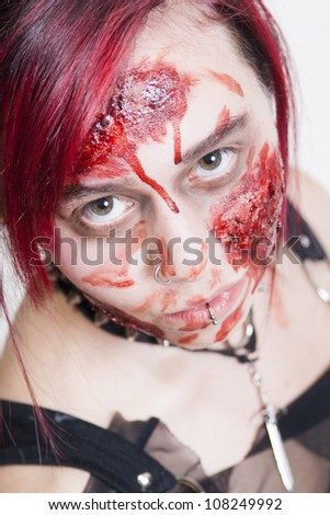 Red Haired Gothic Girl bleeding after accident - stock photo