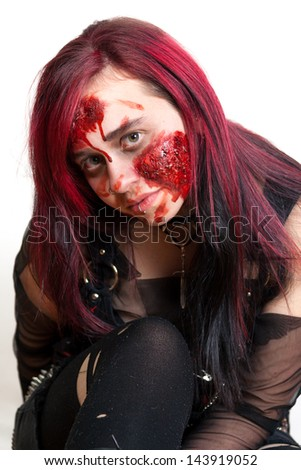 Red haired gothic girl with halloween makeup - stock photo