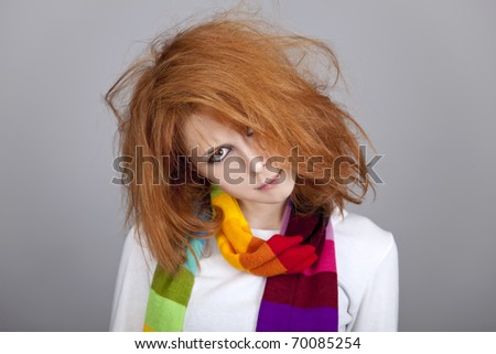 Red-haired rock girl in scarf. - stock photo