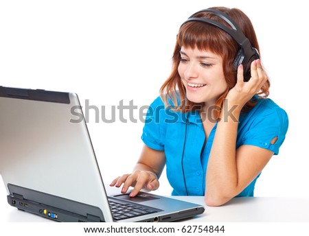 Red-haired teen-girl listen to music in headphones with laptop. Isolated on white background - stock photo