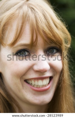 Red-haired woman smiling
