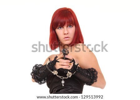 red-haired Woman with gun - stock photo