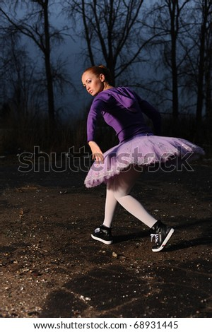 red-haired young ballet perfomer dance in sneakers - stock photo