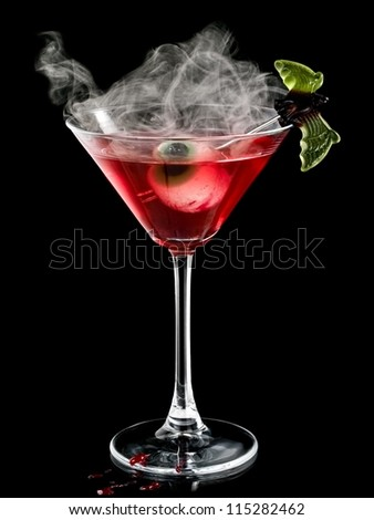 Red halloween cocktail with eye and smoke - stock photo