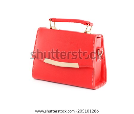 Red handbag of texture leather isolated on white background.