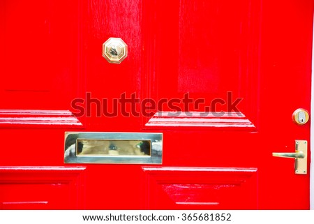 red  handle  in london antique  door  rusty  brass nail and light