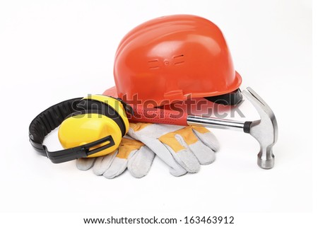 Red hard head gloves and tools. Isolated on a white background